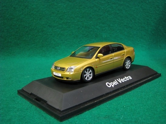 Opel Vectra gold metal 1:43 Minichamps