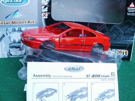 Peugeot 406 coupe red 1997 Kit 1:36 Welly